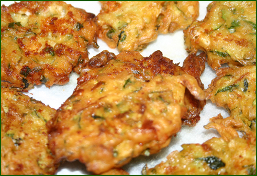 Zucchini fritters look a lot like potato latkes, except without the ...